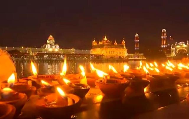 Golden Temple in Amritsar illuminated on 'Parkash Purab' of Guru Ramdas today