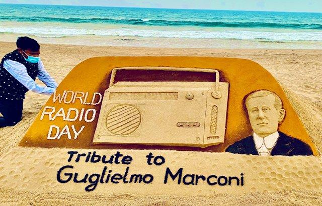 Sudarsan Pattnaik creates sand art paying tribute to Radio Inventor Guglielmo Marconi on World Radio Day.