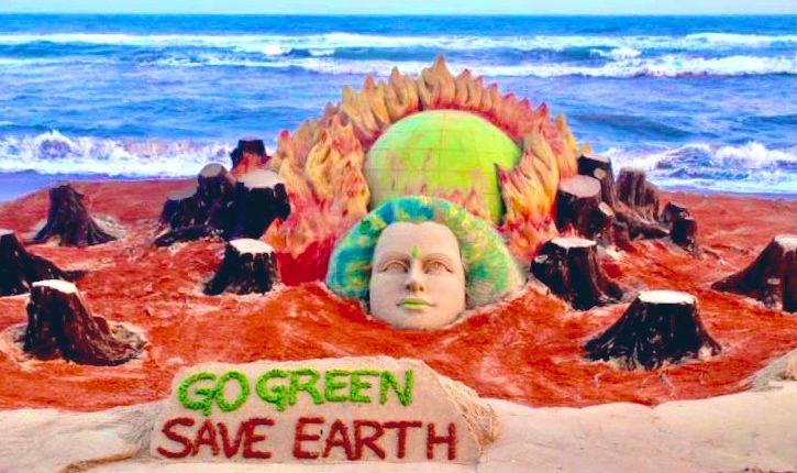 Noted sand artist Sudarsan Pattnaik creates sand art on Earth Day