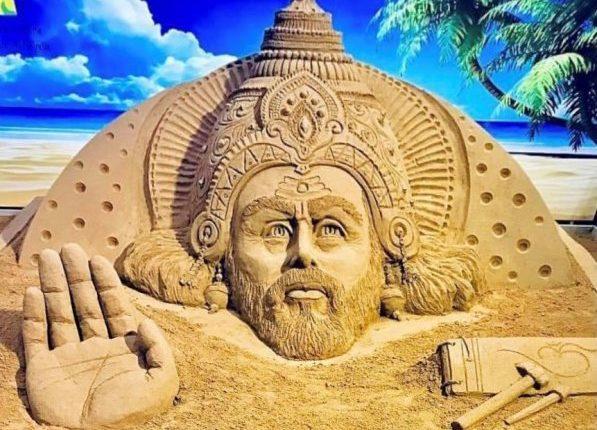Sand artist Sudarsan Pattnaik creates sand art on the occasion of Biswakarma Puja.