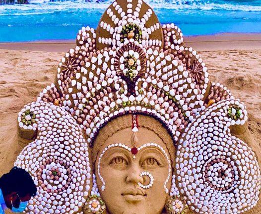 Sand artist Sudarsan Pattnaik creates sand art on the occasion of Maha Saptami of Maa Durga.